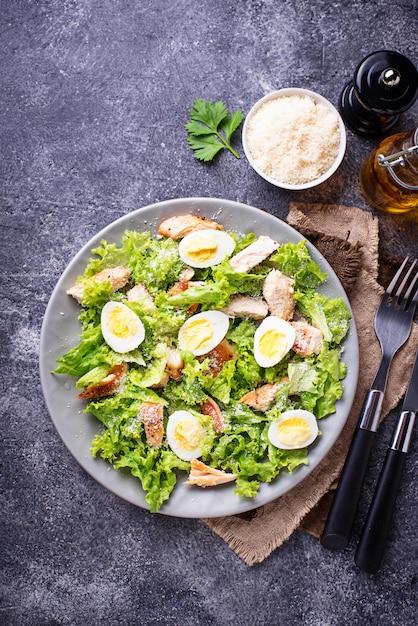 Caesar salad with eggs, chicken and parmesan Premium Photo