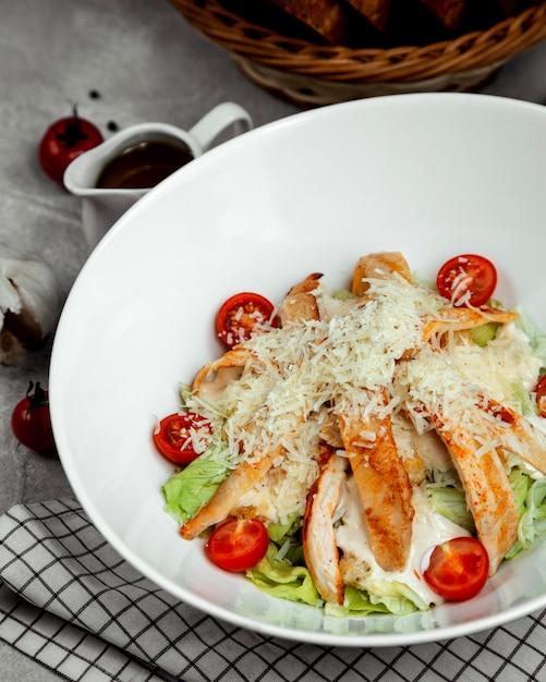 Caesar salad with fried chicken Free Photo