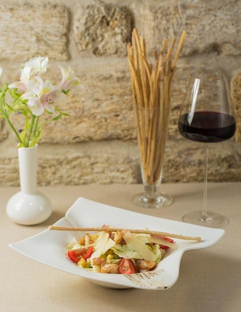Caesar salad with leaf parmesan and thin galetta Free Photo