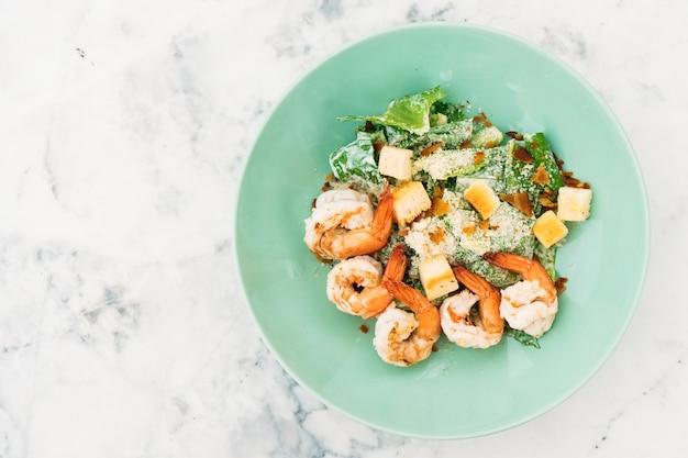 Caesar salad with shrimp or prawn Free Photo