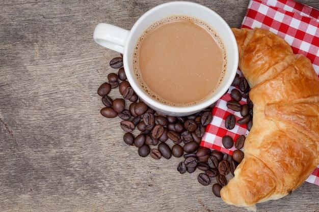 Cafe croissant bread coffee bean Premium Photo