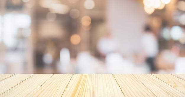 추상 Bokeh 조명이있는 카페 레스토랑 또는 커피 숍 제품 디스플레이 테이블이있는 흐림 배경 Defocused 프리미엄 사진