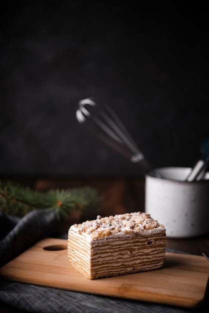 Cake on chopping board with kitchen utensils Free Photo