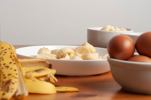 Cake ingredients - banana, eggs, wheat flour, butter, margarine, milk Premium Photo