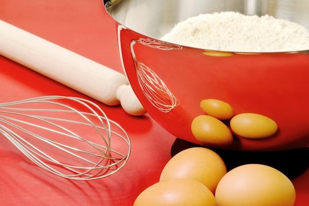 Cake ingredients and confectioner utensils Premium Photo