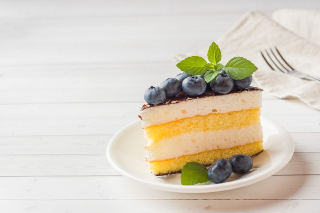 Cake of a souffle with glaze and fresh blueberries. copy space Premium Photo