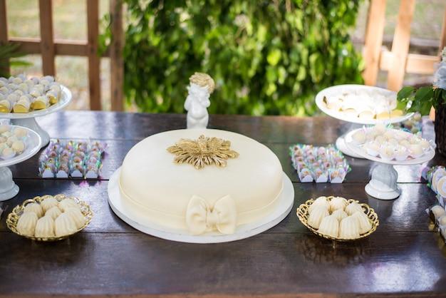 Cake on the table - baptism Premium Photo
