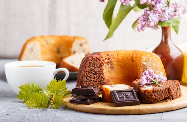 Cakes with raisins and chocolate and a cup of coffee, side view. Premium Photo