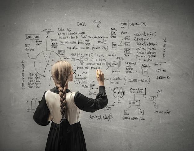 Calculation on a board Premium Photo