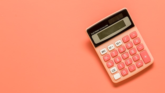 Calculator on colored surface Free Photo