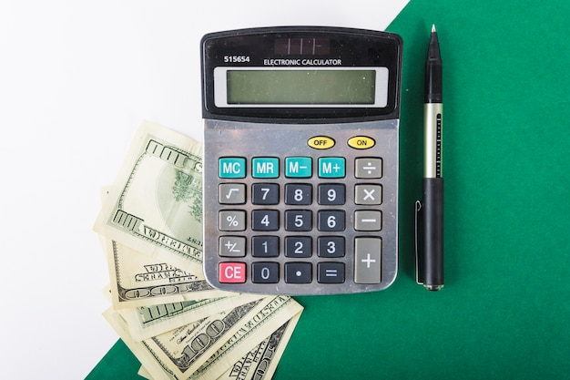 calculator with money on table photo free download