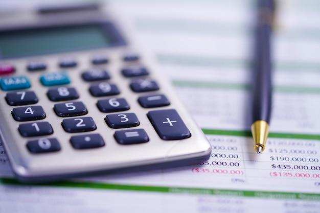 Calculator with pen on spreadsheet paper Premium Photo