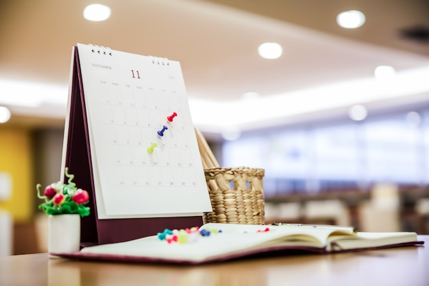 Calendar event planner is busy, planning for business meeting or travel. Premium Photo