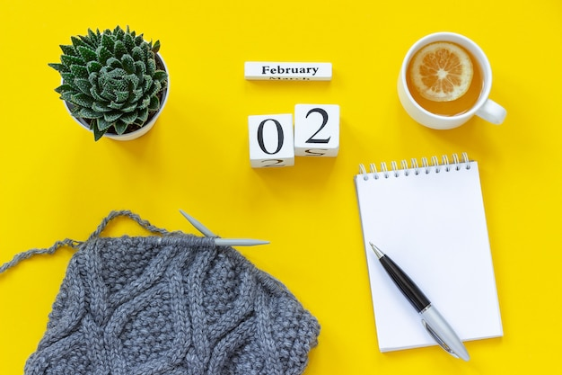 Calendar february 2nd. cup of tea, notepad for text. Premium Photo