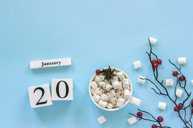 Calendar january 20 cup of cocoa, marshmallows and branch berries Premium Photo