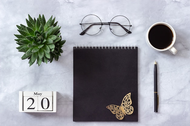 Calendar may 20. black notepad, cup of coffee, succulent, glasses on marble Premium Photo