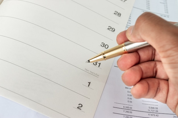 Calendar in a notebook Premium Photo