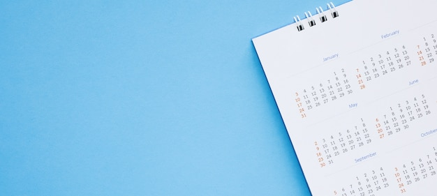 Calendar page close up on blue background business planning appointment meeting concept Premium Photo