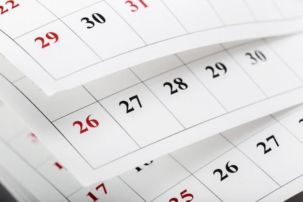 Calendar pages close up business time Premium Photo