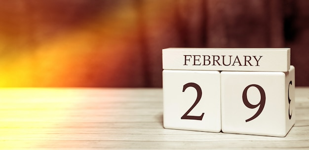 Calendar reminder event concept. wooden cubes with numbers and month on february 29 Premium Photo