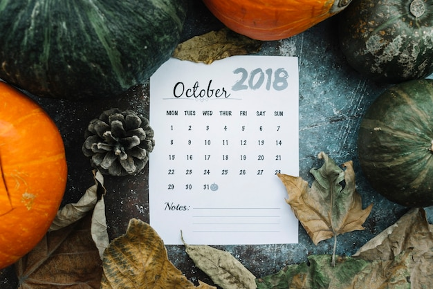 Calendar sheet with halloween date on pumpkins and leaves Free Photo