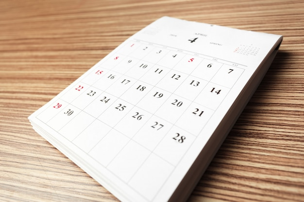 Calendar on wooden table Premium Photo