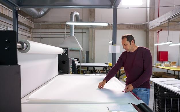 Calender transfer machine production operator man Premium Photo