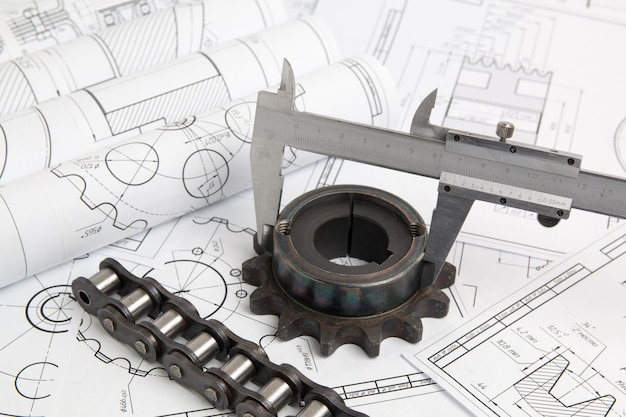 Calipers, sprocket, industrial chain and engineering drawings of industrial parts and mechanisms Premium Photo