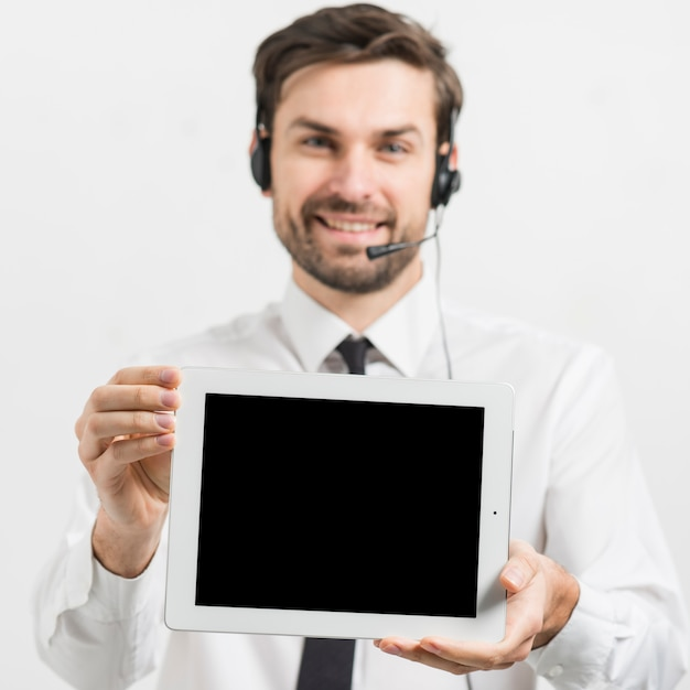 Call center agent presenting tablet template Free Photo