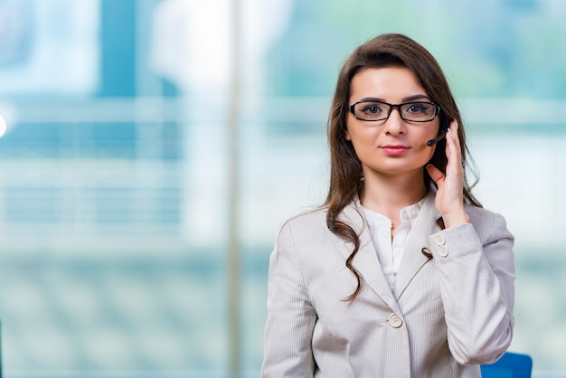 Call center operator working in the office Premium Photo