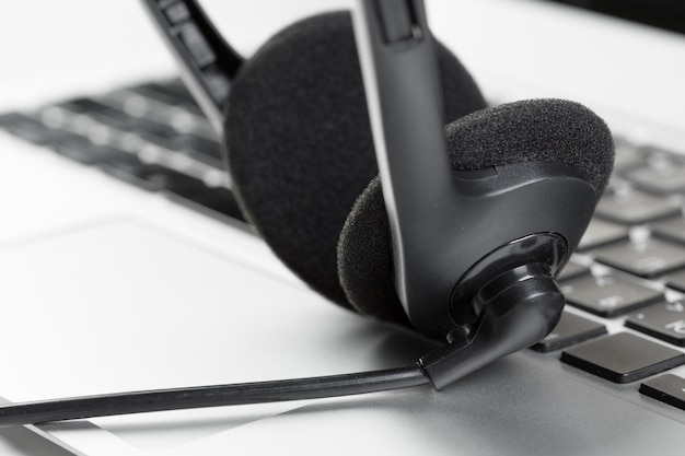 Call center support concept headset on keyboard computer laptop Premium Photo