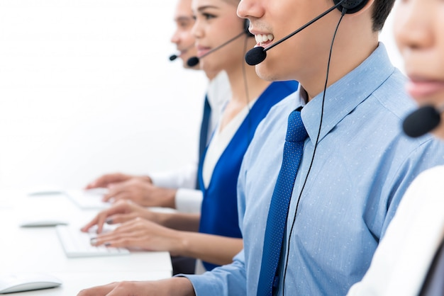 Call centre agents talking on the phone to customers Premium Photo