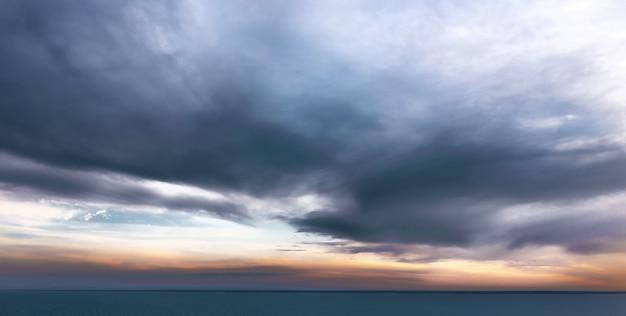 Calm sea with dramatic sky with clouds. tranquil sunset landscape Premium Photo