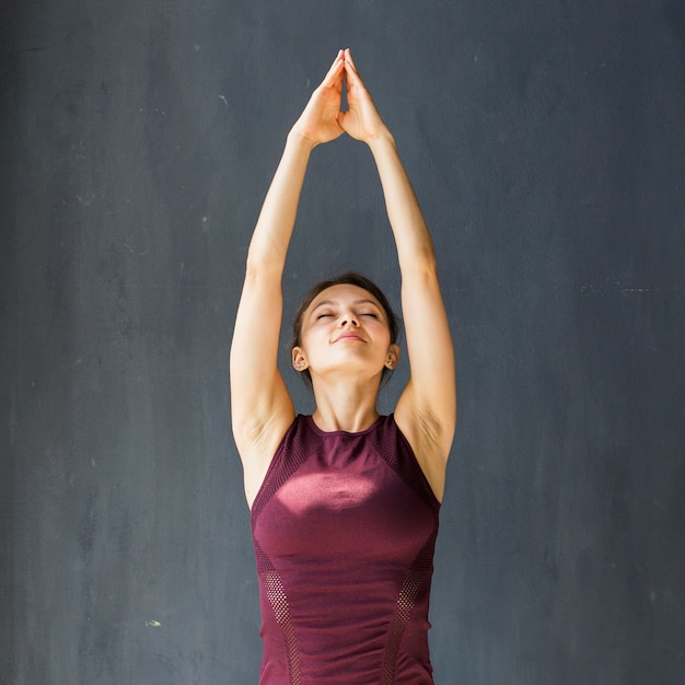 Calm woman performing an upward salute Free Photo