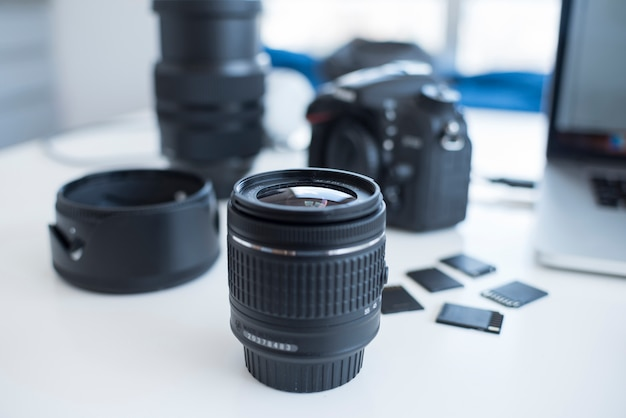Camera accessories with memory cards on desk Free Photo