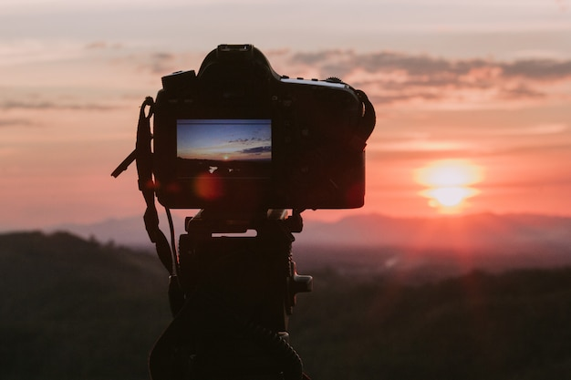 Camera with nature background. Premium Photo