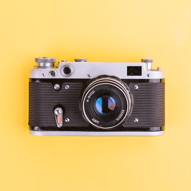 Camera on yellow background Free Photo