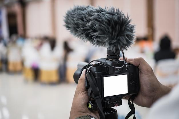 Cameraman video or professional digital mirrorless on tripod for camera recording Premium Photo
