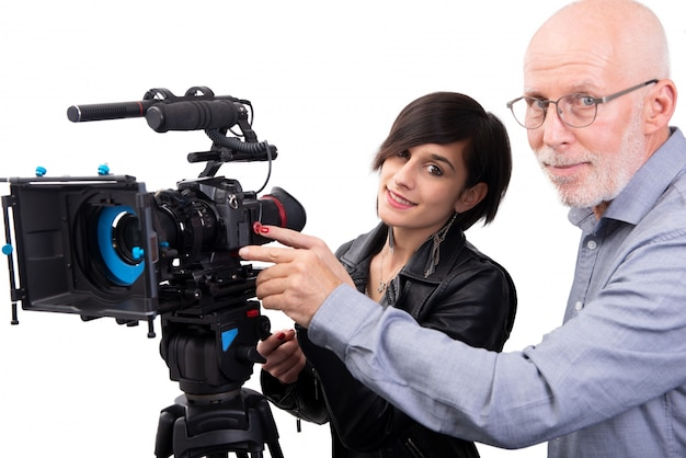 Cameraman and a young woman with a movie camera dslr on white Premium Photo