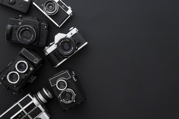 Cameras on black background Free Photo