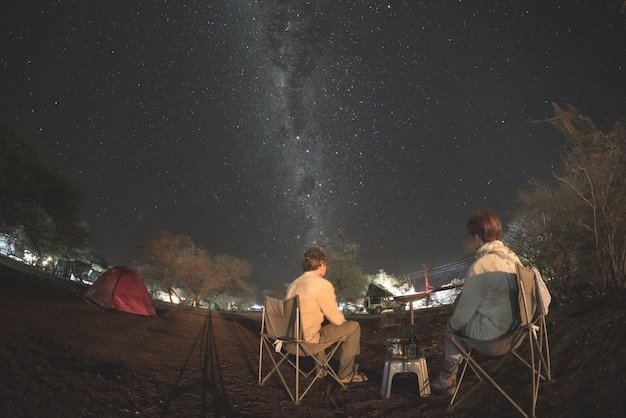 Camping under starry sky and milky way arc Premium Photo