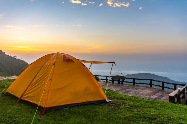 Camping tents on the mountain during sunrise in chiang rai, thailand. Premium Photo