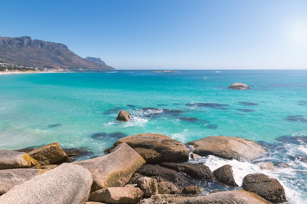 Camps bay beautiful beach with turquoise water and mountains Premium Photo