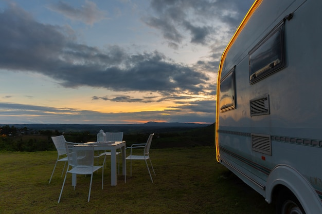 Campsite with caravans at dusk time Free Photo