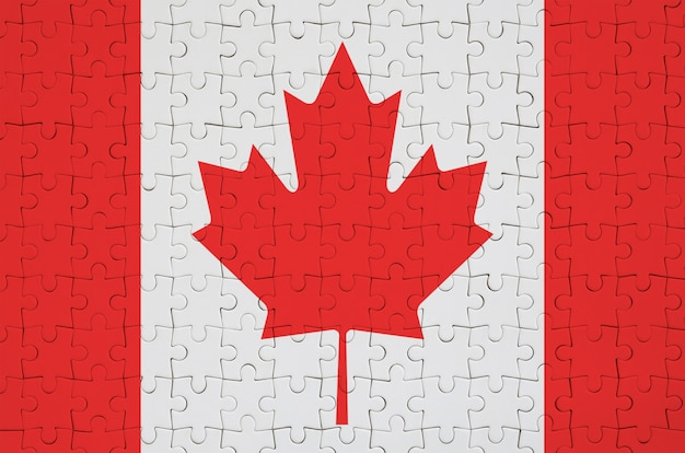 Canada flag  is depicted on a folded puzzle Premium Photo