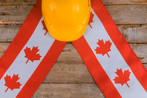 Canada happy labor day greeting card and yellow helmet Premium Photo
