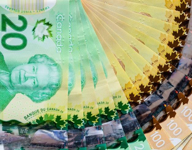 Canadian banknotes of twenty and hundred dollars Premium Photo