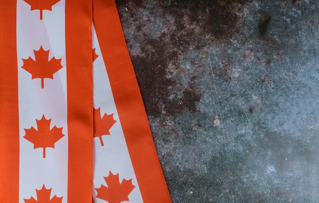 Canadian red and white flag against dark rustic background for canada day celebration and national holidays Premium Photo