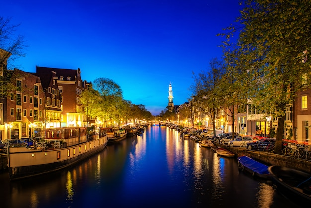 Canals of amsterdam at night in netherlands. amsterdam is the capital and most populous city of the netherlands. Premium Photo