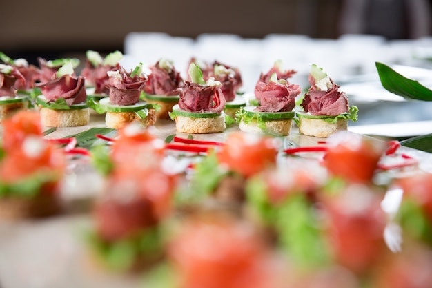 Canapes with Meat and Cucumber on Buffet Table Free Photo